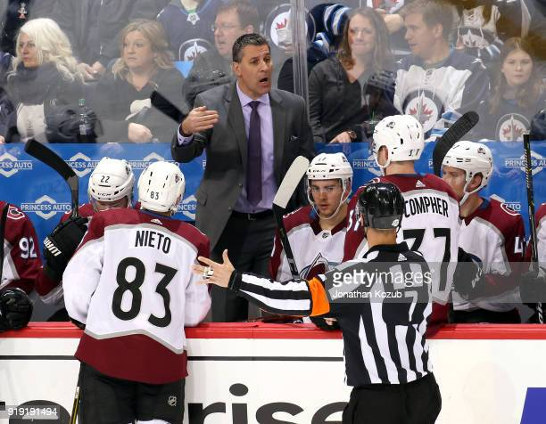 Head Coach Jared Bednar of the Colorado Avalanche argues a call with referee Garrett Rank during a third period stoppage in play against the Winnipeg...