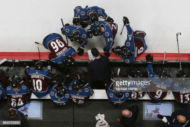Head coach Jared Bednar of the Colorado Avalanche directs his team during a timeout against the Carolina Hurricanes at the Pepsi Center on November 2...