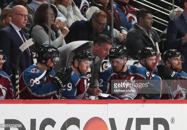 Head coach Jared Bednar of the Colorado Avalanche talks with Mikko Rantanen Nathan MacKinnon and Gabriel Landeskog skates during the game against the...