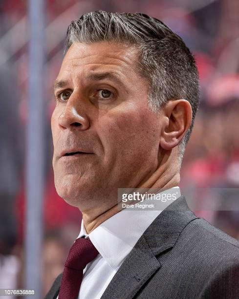 Head coach Jared Bednar of the Colorado Avalanche watches the action from the bench against the Detroit Red Wings during an NHL game at Little...