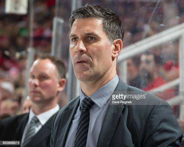 Head coach Jared Bednar of the Colorado Avalanche watches the action from the bench against the Detroit Red Wings during an NHL game at Joe Louis...