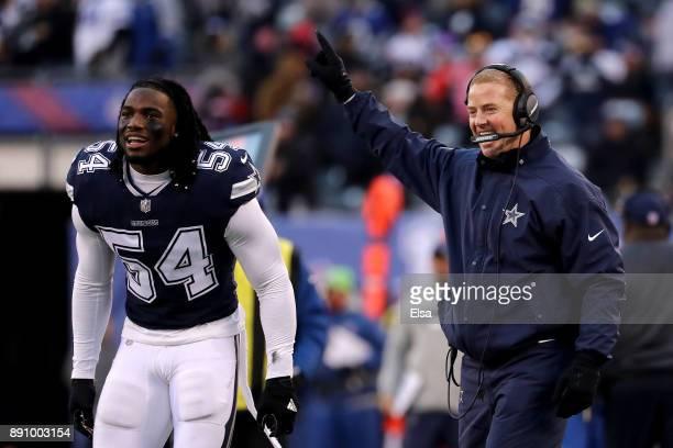 Head coach Jason Garrett and Jaylon Smith of the Dallas Cowboys react against the New York Giants in the fourth quarter during the game at MetLife...