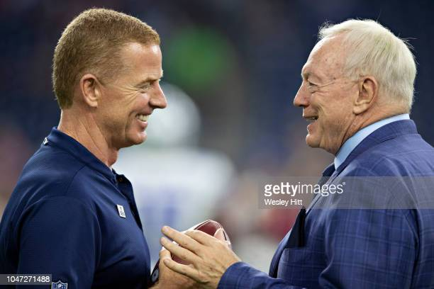 Head coach Jason Garrett and owner Jerry Jones of the Dallas Cowboys talk on the field before the game against the Houston Texans at NRG Stadium on...