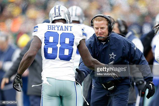 Head coach Jason Garrett celebrates with Dez Bryant of the Dallas Cowboys after a touchdown against the Green Bay Packers to the 2015 NFC Divisional...