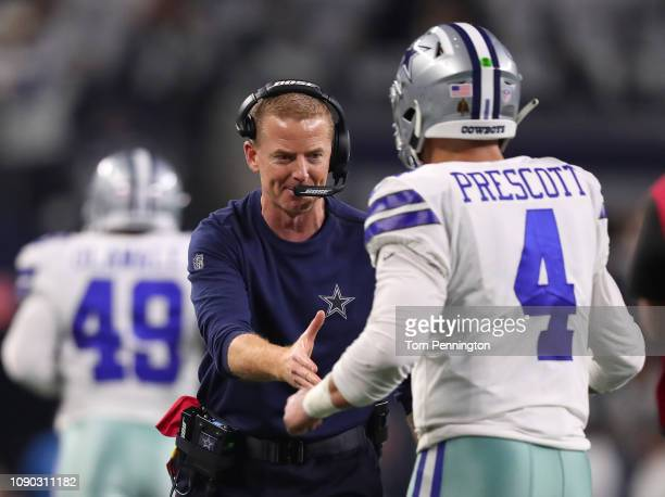 Head coach Jason Garrett congratulates Dak Prescott of the Dallas Cowboys after the go ahead touchdown by Ezekiel Elliott in the fourth quarter...