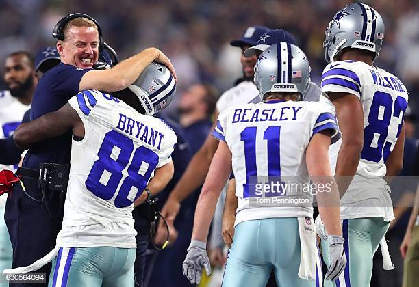 Head coach Jason Garrett of the Dallas Cowboys celebrates with Dez Bryant after Bryant threw a touchdown pass against the Detroit Lions as Cole...