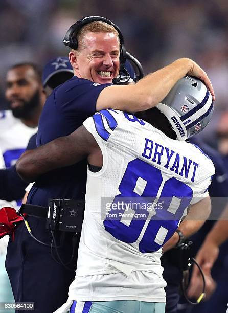 Head coach Jason Garrett of the Dallas Cowboys celebrates with Dez Bryant after Bryant threw a touchdown pass against the Detroit Lions during the...