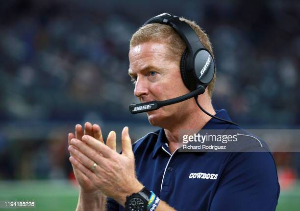 Head coach Jason Garrett of the Dallas Cowboys claps on the sidelines near the end of the game against the Los Angeles Rams at AT&T Stadium on...