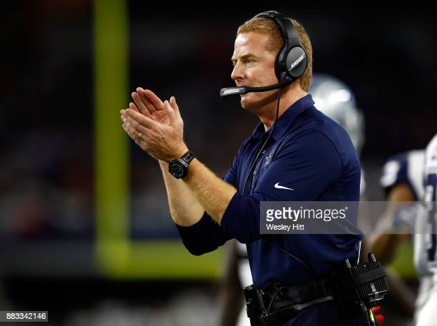 Head coach Jason Garrett of the Dallas Cowboys claps on the sidelines during a football game against the Washington Redskins at ATT Stadium on...
