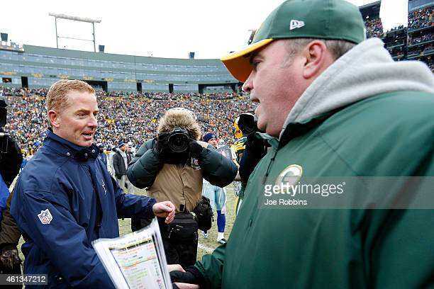 Head coach Jason Garrett of the Dallas Cowboys congratulates head coach Mike McCarthy of the Green Bay Packers after the 2015 NFC Divisional Playoff...