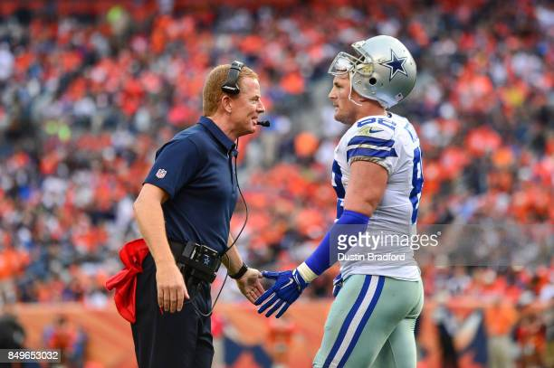 Head coach Jason Garrett of the Dallas Cowboys gives a high five to tight end Jason Witten during a game against the Denver Broncos at Sports...