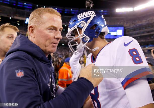 Head coach Jason Garrett of the Dallas Cowboys greets Daniel Jones of the New York Giants after the game at MetLife Stadium on November 04, 2019 in...