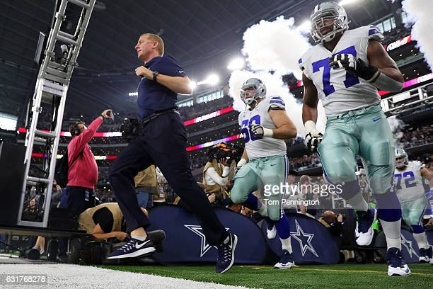 Head coach Jason Garrett of the Dallas Cowboys leads his team onto the field prior to the NFC Divisional Playoff game against the Green Bay Packers...