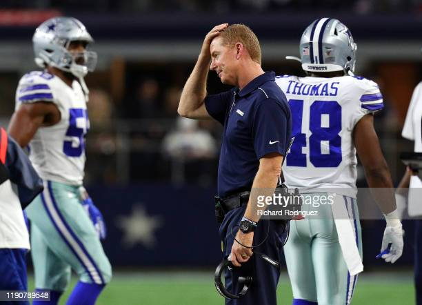 Head coach Jason Garrett of the Dallas Cowboys rubs his head during the game against the Buffalo Bills at AT&T Stadium on November 28, 2019 in...