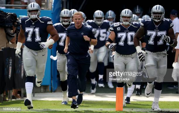 Head coach Jason Garrett of the Dallas Cowboys takes the field against the Carolina Panthers at Bank of America Stadium on September 9 2018 in...