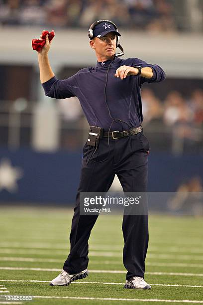 Head Coach Jason Garrett of the Dallas Cowboys throws the red flag to question a call during a game against the Seattle Seahawks at Cowboys Stadium...