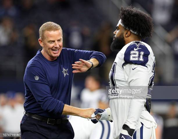 Head coach Jason Garrett shakes hands with Ezekiel Elliott of the Dallas Cowboys during warmups before the game against the New Orleans Saints at ATT...