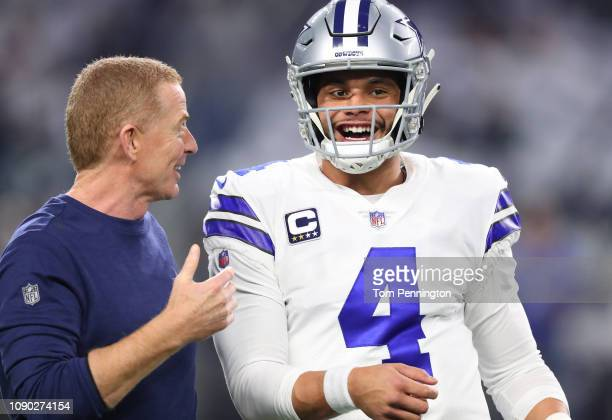 Head coach Jason Garrett visits with Dak Prescott of the Dallas Cowboys before the game against the Seattle Seahawks during the Wild Card Round at...