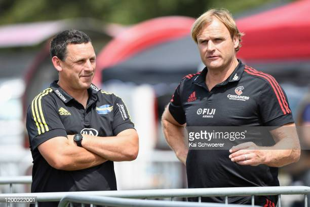 Head Coach Jason Holland of the Hurricanes and Head Coach Scott Robertson of the Crusaders look on prior to the Super Rugby preseason match between...