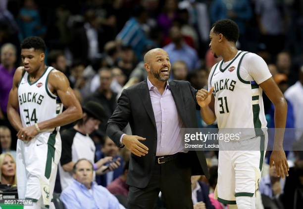 Head coach Jason Kidd talks to his player John Henson of the Milwaukee Bucks against the Charlotte Hornets during their game at Spectrum Center on...