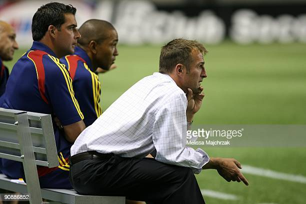 Head Coach Jason Kreis of Real Salt Lake sits on the bench during the game against the Chicago Fire at Rio Tinto Stadium on September 12 2009 in...