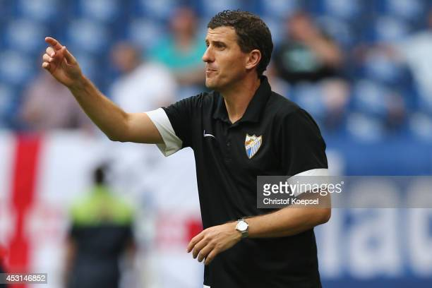 Head coach Javi Gracia of Malaga issues instructions during the match between FC Malaga and West Ham United as part of the Schalke 04 Cup Day at...