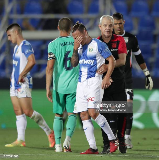 Head coach Javier Aguirre of Leganes consoles Jonathan Silva after the Liga match between CD Leganes and Real Madrid CF at Estadio Municipal de...