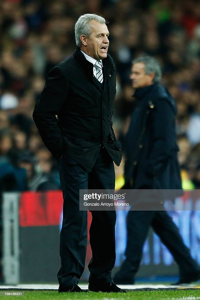 Head coach Javier Aguirre of RCD Espanyol gives instructions behind him Head coach Jose Mourinho of Real Madrid CF during the La Liga match between Real Madrid CF and RCD Espanyol at Estadio Santiago Bernabeu on December 16, 2012 in Madrid, Spain.