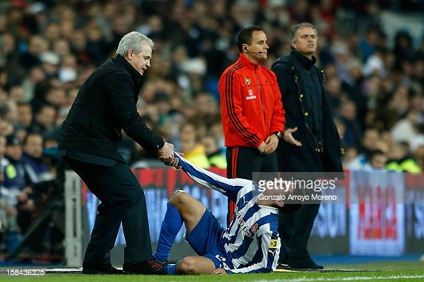 Head coach Javier Aguirre of RCD Espanyol helps player Christian Alfonso Lopez behind them Head coach Jose Mourinho of Real Madrid CF complains...