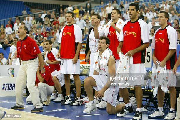Head coach Javier Imbroda of Spain yells out in the final seconds of his team's game as the rest of the players look on 30 August, 2002 during their...