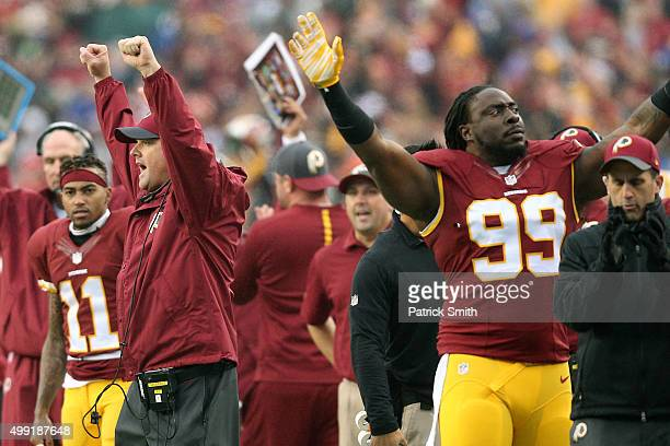 Head coach Jay Gruden and defensive tackle Ricky Jean Francois of the Washington Redskins react to a play against the New York Giants in the second...