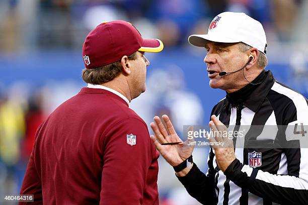 Head coach Jay Gruden of the Washington Redskins argues with Referee Jeff Triplette after Robert Griffin III of the Washington Redskins touchdown...
