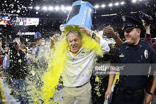 Head coach Jay Hopson of the Southern Miss Golden Eagles is dunked with Powerade after a game at the MercedesBenz Superdome on December 17 2016 in...