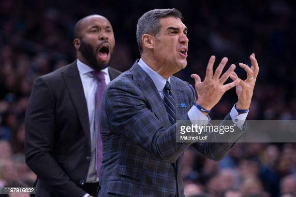 Head coach Jay Wright and assistant coach Kyle Neptune of the Villanova Wildcats react against the Creighton Bluejays in the first half at the Wells...
