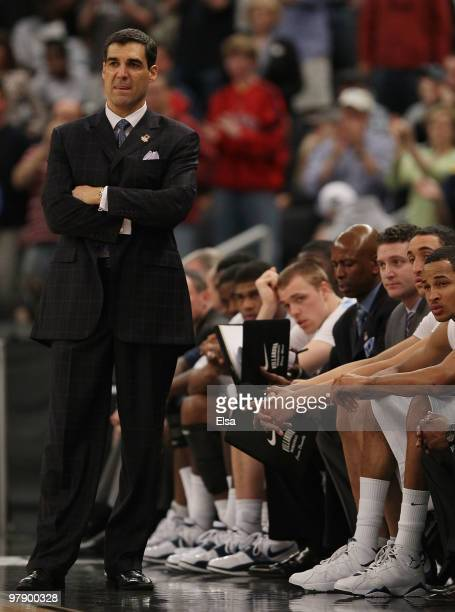 Head coach Jay Wright and the rest of the Villanova Wildcats bench watch in the final minutes of the game as they lose to the Saint Mary's Gaels...