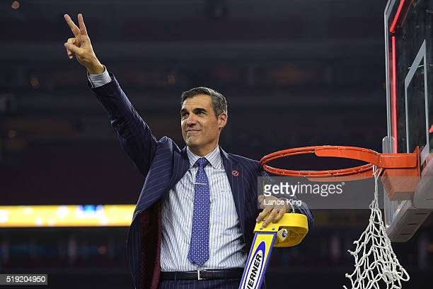 Head coach Jay Wright of the Villanova Wildcats acknowledges fans after cutting the net following their 77-74 victory against the North Carolina Tar...