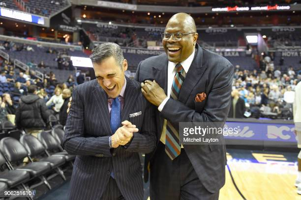 Head coach Jay Wright of the Villanova Wildcats and head coach Patrick Ewing of the Georgetown Hoyas talk before a college basketball game at the...