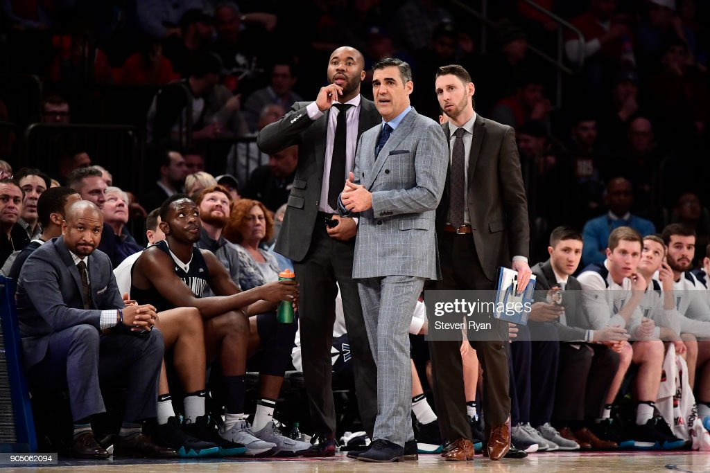 Head coach Jay Wright of the Villanova Wildcats and his staff look on against the St. John's Red Storm during an NCAA men's basketball game at Madison Square Garden on January 13, 2018 in New York City.