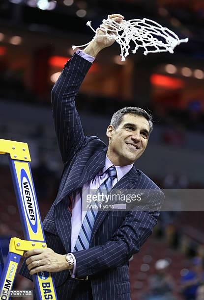 Head coach Jay Wright of the Villanova Wildcats celebrates defeating the Kansas Jayhawks 6459 during the 2016 NCAA Men's Basketball Tournament South...