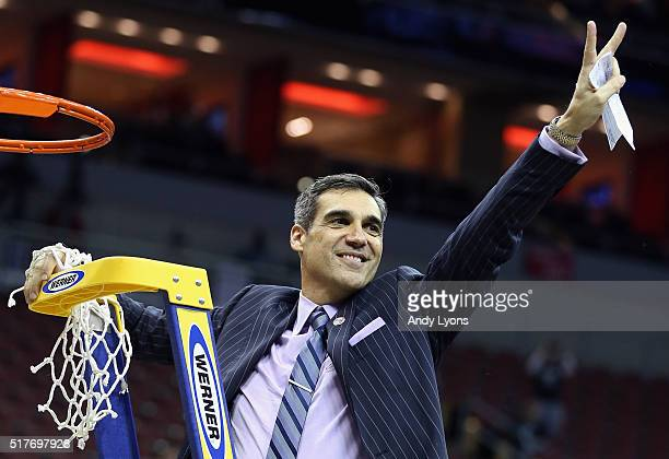 Head coach Jay Wright of the Villanova Wildcats celebrates defeating the Kansas Jayhawks 64-59 during the 2016 NCAA Men's Basketball Tournament South...
