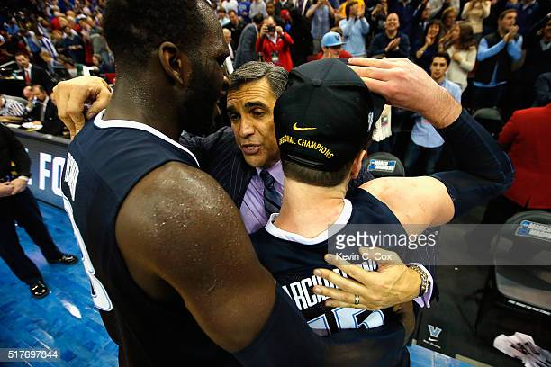 Head coach Jay Wright of the Villanova Wildcats celebrates with Daniel Ochefu and Ryan Arcidiacono after defeating the Kansas Jayhawks 6459 during...