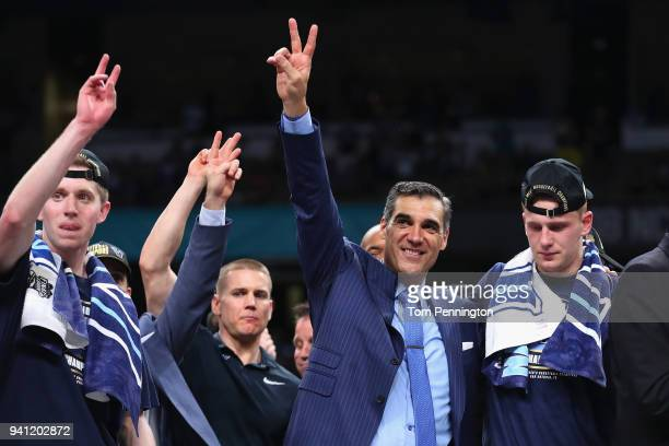 head coach Jay Wright of the Villanova Wildcats celebrates with his team after defeating the Michigan Wolverines during the 2018 NCAA Men's Final...