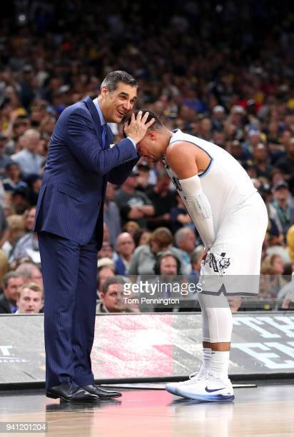 Head coach Jay Wright of the Villanova Wildcats celebrates with Jalen Brunson late in the second half against the Michigan Wolverines during the 2018...