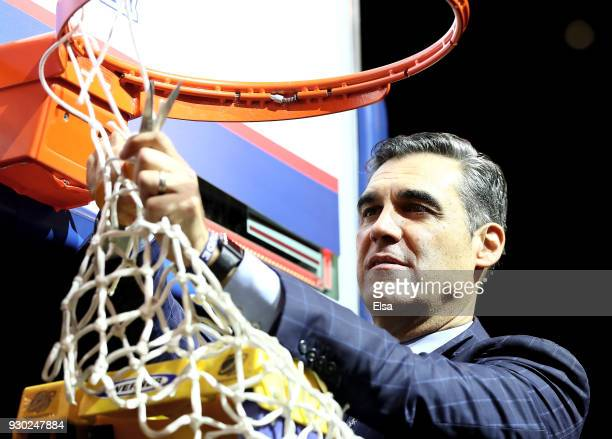 Head coach Jay Wright of the Villanova Wildcats cuts a piece of the net after the defeated Providence Friars to win the championship game of the Big...