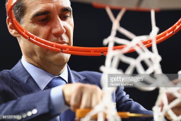 Head coach Jay Wright of the Villanova Wildcats cuts down the net after defeating the Michigan Wolverines during the 2018 NCAA Men's Final Four...