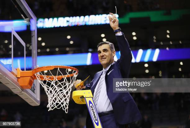 Head coach Jay Wright of the Villanova Wildcats cuts the net after defeating the Texas Tech Red Raiders 71-59 in the 2018 NCAA Men's Basketball...