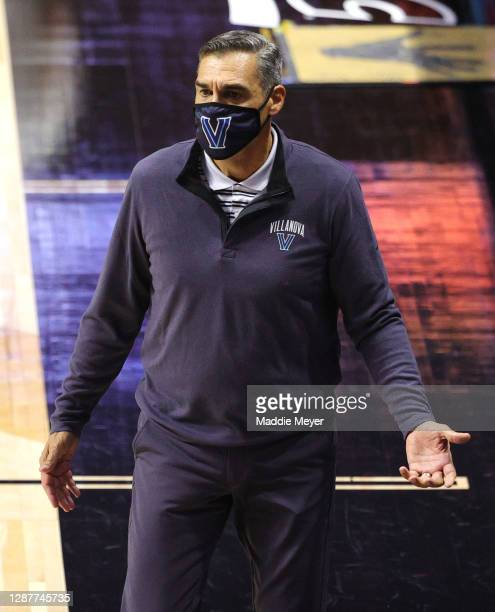 Head coach Jay Wright of the Villanova Wildcats disputes a call in the first half against the Boston College Eagles during the 2K Empire Classic at...