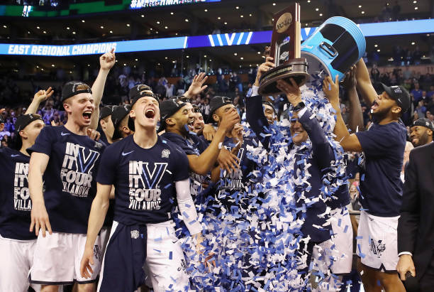 Head coach Jay Wright of the Villanova Wildcats holds the East Regional Champion trophy after defeating the Texas Tech Red Raiders 7159 in the 2018...