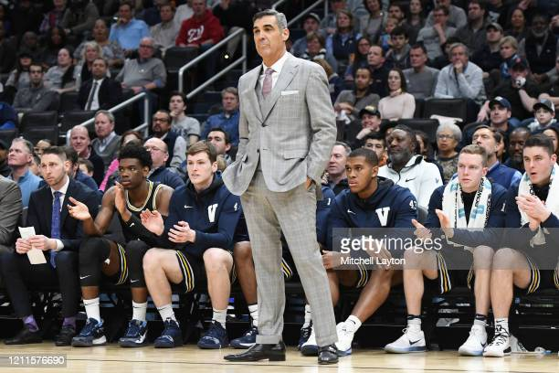 Head coach Jay Wright of the Villanova Wildcats looks on during a college basketball game against the Georgetown Hoyas at the Capital One Arena on...