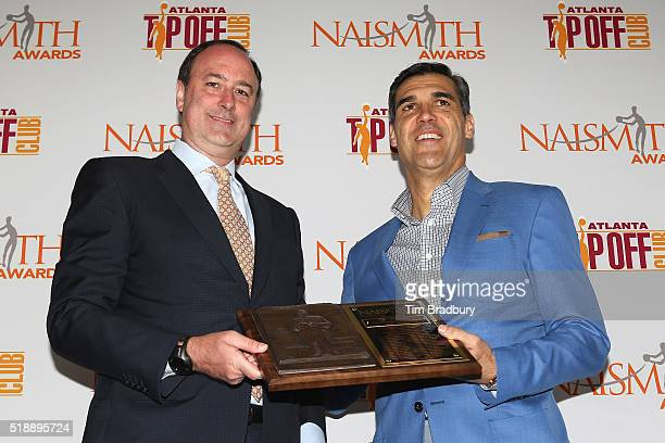 Head coach Jay Wright of the Villanova Wildcats poses with Barry Goheen Chairman of King Spalding LLP after being named the 2016 Naismith College...